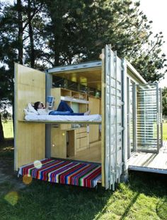 This fold out open air bed in this container home is a terrific idea