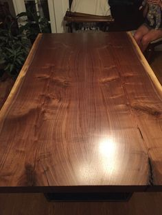 Beautiful live edge black walnut dining table with 1x3 trapezoid legs. 100% Canadian made! Locally owned, locally sourced and locally crafted! At Plank To Table Design Inc. we do it all. Click the dimensions tab for pricing or request a custom quote if you have an awesome idea that we