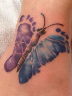 My son and daughters baby foot prints made into a butterfly tattoo