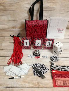 12 Person Basic Bunco Kit- Red and Zebra Print Theme  Included in Kit: • 1 Call Bell • 6 white and 3 red Dice & Coin purse for storing •