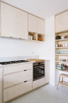 Pale wood Scandinavian inspired modern minimalist kitchen. Love the open shelving and little cubby
