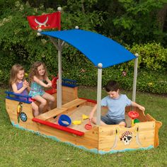 The Kidkraft Pirate Sandboat is made of wood and large enough that multiple children can play at once. The Kidkraft Pirate Sandboat has a canopy to keep kids out of the sun, a steering wheel and 2 convenient storage compartments to store sand toys. Kids Outdoor Play, Outdoor Fun, Backyard Kids, Childrens Outdoor Toys, Outdoor Learning Spaces, Outdoor Playground, Outdoor Spaces, Sandbox Cover, Bateau Pirate