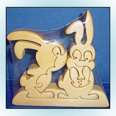 This solid wood scroll saw animal puzzle set is still sealed in the original packaging. The elephants measure about 5.5 inches by 6 inches; the rabbits measure about 6.25 inches by 6.5 inches; the cows measure about 4.25 inches by 6 inches; and the horse measures about 5.5 inches by 8