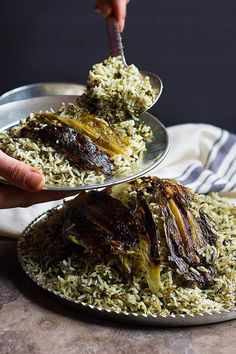 Sabzi Polo is a delicious Persian herb rice that& served with fish for Persian new year. Rice mixed with a selection of aromatic herbs makes this a great side dish to serve when you& feeding a crowd! Iranian Cuisine, Iranian Food, Vegetarian Recipes, Cooking Recipes, Pasta, Middle Eastern Recipes, Mediterranean Recipes, Kraut, Gourmet