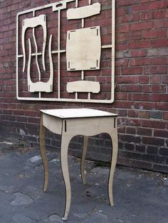 """Damaged Goods (Close up), Flat pack table. Sort of postmodern in the """"decorative"""" leg shape. This kind of flat pack could be used to allow for customization. Only uses 1 sheet of plywood. Folding Furniture, Cardboard Furniture, Furniture Plans, Cool Furniture, Furniture Design, Furniture Removal, Furniture Stores, Dollhouse Furniture, Plywood Projects"""