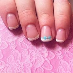Bows are dainty and demure (and not that hard to do with a nail art pen): | 16 Ways To Play Up Your French Manicure