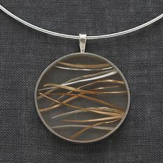 """Carla Pennie McBride: , Pendant in sterling silver, goldfill and resin. Pendant is 1.5 x 1.25"""". 18"""" silver choker."""