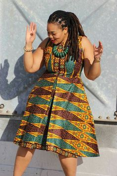 Another classic African Print dress. This dress is earthy in all its glory. The color commands attention when you walk into any room. The inverted pleats and pockets are not a must, but a plus in my book.
