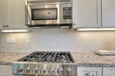 Try a basketweave kitchen backsplash over granite countertops for something different and unique.