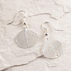 In a silver finish, these intricate gingko leaf-inspired earrings are a delicate addition to any day or night look.