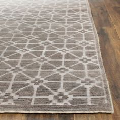 KNS920A Rug from Kensington collection.  Sophisticated as Savile Row, Kensington collection rugs feature menswear geometrics gone chic. The small-scale patterns are hand-knotted in a Persian weave