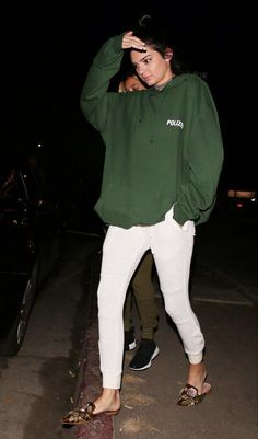 Kendall Jenner wearing Vetements Polizei Hoodie in Green, Lili Claspe Sabrina Choker in Gold, Shadow Hill Antique Natural Thermal Sweats and Alberta Ferretti Flat Velvet Mules in Cognac