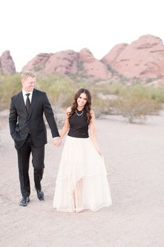Romantic desert engagement session. Ivory chiffon skirt paired with a black suit.