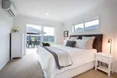 Rebecca Ward & Patrick Wilde's stunning master bedroom which opens out onto their large deck.   #ourstories #clientreferences #master #bedroom #interiordesign #sleep #newhome #house #generationhomesnz