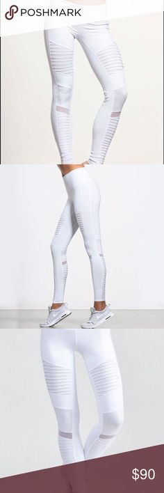 ALO Yoga White Moto Leggings NEW XS Celebrity favorite! ❤️ SOLD OUT! These leggings are BRAND NEW without tags! I have several pair and seem to only wear my high waisted ones and they hid my belly ☺️ These have never been worn...time to part with them so someone new can enjoy their beauty and comfort! Never worn, so there is not a single spot on them. I purchased them at Nordstrom for $110 plus tax was $127.. Thy have satin and mesh panels as shown in the photo! Enjoy!  ALO Yoga Pants…