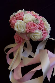 A pretty bouquet of pink and white real touch roses with some white sago flowers to add that extra touch of class. Beautiful ribbons of pink and white fall down the handle to create that beautiful flow effect.  All bouquets can be reproduced in the size and colour of your choice. Feel free to mix and match ideas to make your bouquet more individual. Corsage, MOB and Lapel pins are also available to match your colours. Contact leeann@bejewelledbridal.com.au for more information.