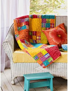 Vibrant Mango Quilt  Each block of this vibrant quilt uses nine different fabrics --  assorted stripes, plaids, and solids. The bright colors make this quilt a perfect spring or summer accessory.  Quilts would be fun for the porch and deck for cool evenings...