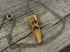 Carved Wolf Track on Antler Necklace. $15.00, via Etsy by WoodlandsWanderer