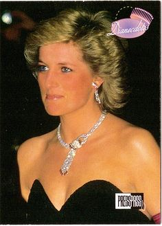 Princess Diana wearing her diamond and ruby demi-parure. The pendants on the earrings can be removed and replaced by pearls.