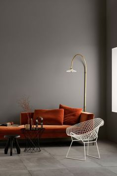 Luscious burnt orange velvet chair, perfectly paired with a brass floor lamp...a calming atmosphere to relax. #interiordesign #velvetlounge #brassfloorlamp #livingroominspo #interiordecor #interiorstyling #plushvelvet #warmtones #livingspace #woodsandwarner #northshoreinteriordesigners #interiordecoration