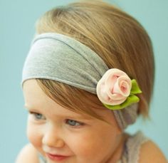 Adorable Pink rose headband for baby girls. Soft cotton flower on grey jersey stretchy knit that fits most babies head size comfortably. Head