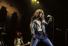 Joey Ramone performs with The Ramones in the 1990 photo by Ebet Roberts
