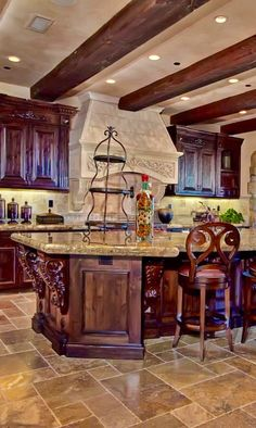 Beautiful Tuscan style kitchen.  Wood beams add such a warm touch.   #LimitlessDesign #Contest