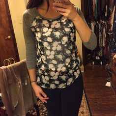 Floral baseball Tee Adorable!  Heather grey sleeves, semi sheer floral print.  Wear over a Camisole.  Love this paired with jeans for an everyday cute and casual look! Tops