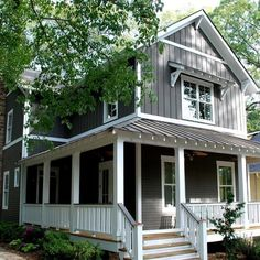 exterior color scheme dark grey/purple, white trim, natural wood and green. Maybe even metal?