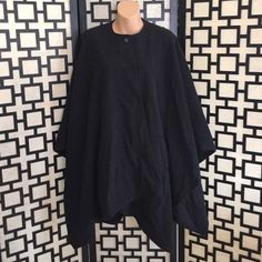 Harve Benard Grey wool cape Very dark charcoal grey, near black. Has one button to secure it up by the neck. Cloak style. Wool blend and very warm. Absolutely perfect condition. Harve Benard Jackets & Coats Capes