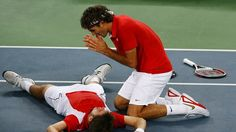 Roger Federer (right) and Stanislas Wawrinka of Switzerland celebrate after defeating Thomas Johansson and Simon Aspelin of Sweden during the men's doubles gold medal tennis match at the Olympic Green Tennis Center on Day 8 of the Beijing 2008 Olympic Gam
