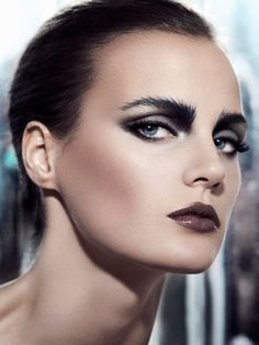 Photographed by Yann Ostiguy for Dress to Kill Magazine. Very cool effect with the eyebrows. Amazing dark and brooding eyes.