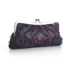 Our lavish 10 w x 4 12 h Aubergine dark  purple satin evening bag boasts iridescent Eggplant bugle beads, seed  beads, sequins & purple gems. Our dressy beaded clutch purse has a  silver frame & kiss clasp with detachable silver wrist &  shoulder chains.     This captivating Eggplant evening bag will accessorize  any Aubergine dress for weddings, mothers of the brides, galas,  bridesmaids or nights on the town. This iridescent purple beaded evening  clutch purse has gene