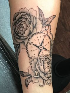Peony tattoo and compass done by Kira Teter