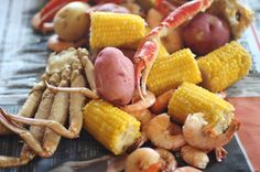 Shrimp and Crab Boil, Shrimp and snow crab clusters boiled in seasoned water and scattered on newspaper down the center of the table for fine causal dining. Shrimp And Crab Boil, Crab Stuffed Shrimp, Seafood Boil, Seafood Dishes, Fish And Seafood, Boiled Shrimp, Shrimp Dip, Shrimp Recipes, Fish Recipes