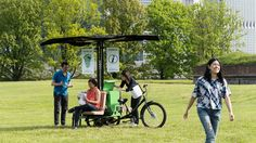 The park's Mobile Information Units, still in the prototype stage, unfold from the back of a customized bicycle.