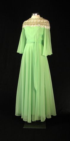 A green gown designed by Luis Estevez for First Lady Betty Ford, worn during a reception hosting Queen Elizabeth II and Prince Philip of the United Kingdom. 1976.