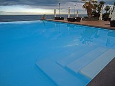 Enjoy yourselves by the #pool overlooking the amazing #Ionian #Sea at Santa Tecla Palace #Hotel in #Sicily. www.santateclapalace.com | #TraveltoSicily #Travel