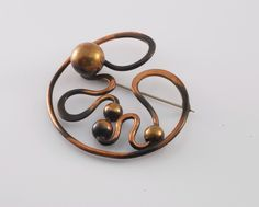 Brooch/Pin |  Art Smith; sculptural copper pin with copper balls