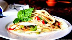 Breakfast Crepes filled with Cheese and Veggies Recipe Breakfast and Brunch with all-purpose flour, skim milk, salt, sugar, baking soda, eggs, scallions, green pepper, red pepper, mushrooms, canola oil, salt, pepper, pepper jack, mozzarella cheese