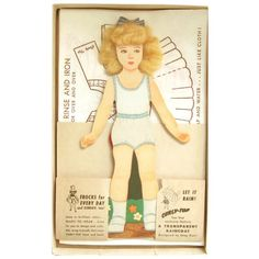 Vintage 40's Blond Hair CURLY TOP Boxed Paper Doll Complete with 9 Costumes, Some to Color; Wrap Around Front and Back with Scissors and Transparent Raincoat