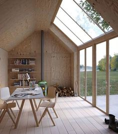 This archetypal Swedish building form, shaped like a Monopoly house, serves as an artist's studio, with a simple plywood interior and massive skylights to let in natural sunlight. Architecture + Photo by Waldemarson Berglund Arkitekter Tiny Homes, New Homes, Prefab Homes, Plywood Interior, Casas Containers, Garden Studio, Backyard Studio, Backyard Ideas, Backyard Designs