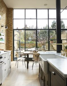 A little bit industrial, a little bit English country, this Victorian south London home has exposed brick walls, Crittall doors and a country kitchen. Crittal Windows, House Design, Floor To Ceiling Windows, Glass Extension, House, Dream Decor, Modern House, Exposed Brick, New Homes