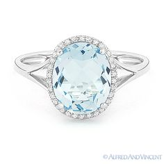 The featured ring showcases a checkerboard oval cut blue topaz & round cut diamond accents set in a 14k white gold halo setting with splitshank bands.