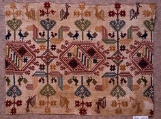 Design of geometric forms with stylized plants and birds in red, yellow, blue, green and tan on white ground. Embroidery Motifs, Silk Ribbon Embroidery, Embroidery Fashion, Cross Stitch Embroidery, Cross Stitch Patterns, Embroidery Designs, Greek Pattern, Vintage Cross Stitches, Cross Stitch Bird