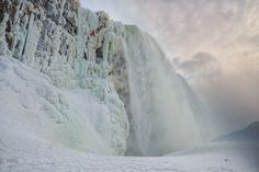 That little red dot near the top of the frozen Niagara Falls? That's a person. Ice climbing Niagara Falls.