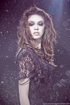 Dark Snow Fashion Photography - Sara - Exclusive Image LLC. Created in a blizzard with a popup backdrop and speedlites.