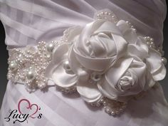 Bridal Sash - White satin Rose sash with pearls and lace. $175.00, via Etsy. www.etsy.com/shop/lucy2s #recycled, #ecowedding, #bridalsash, #wedding, #whiteroses, #pearls