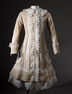 I want this dress! Perfect Gothic lolita dress... Victorian all the way! Matching dress for myself and my dollies, matching hijab for me' bonnets for them!!! A very cute girl's linen dress with eyelet trim made in England circa 1885.