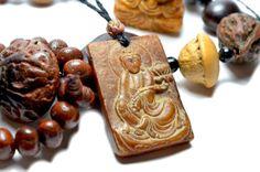 Mercy Yin Buddha Carved Dark Red Jade Amulet by FortuneJadeJewelry, £74.99